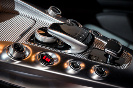 AMSTERDAM - APR 16, 2015: Interior centre console of a Mercedes-AMG sports car at the Amsterdam AutoRAI 2015 Motor Show. Editorial