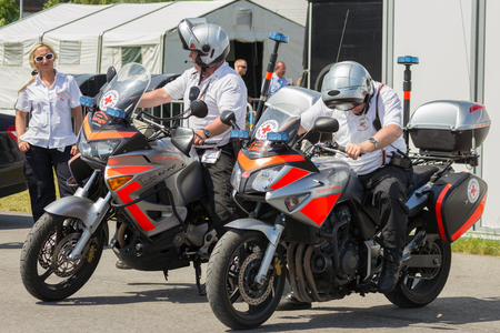 BERLIN - JUL 11, 2013:  German red cross (Deutsches Rotes Kreuz) motor bikes and personnel during the ILA event.