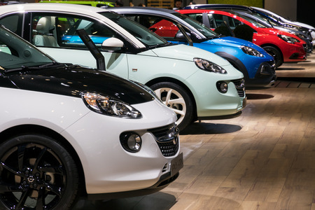 BRUSSELS - JAN 10, 2018: Row of Opel Adam economic city cars shown at the Brussels Motor Show.