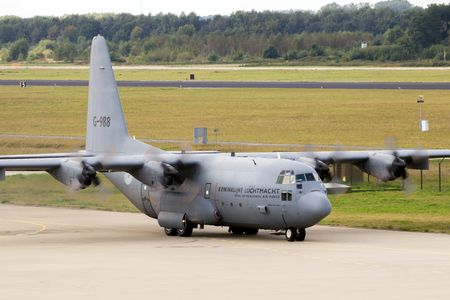 EINDHOVEN, THE NETHERLANDS - SEP 17, 2016: Royal Netherlands Air Force Lockheed C-130 Hercules cargo plane taxiing to the runway of Eindhoven Airport.