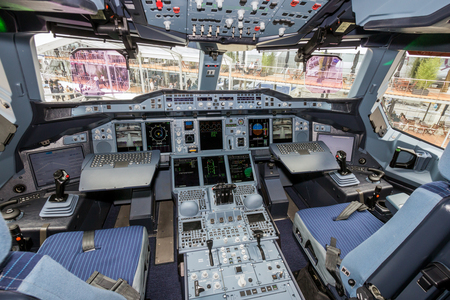 PARIS - JUN 18, 2015: Airbus A380 cockpit. The A380 is the largest passenger airliner in the world.