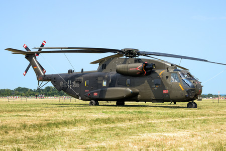 NORVENICH, GERMANY - JUNE 12, 2015: Germany Army Sikorsky CH-53 transport helicopter on the grass of Norvenich airbase. Editorial