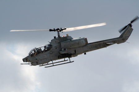 MIRAMAR, CALIFORNIA, USA - OCT 15, 2016: Bell AH-1 SuperCobra attack helicopter in flight during the MCAS Miramar Airshow. Editorial