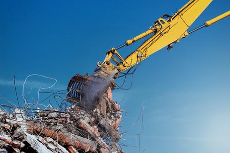 Demolition crane dismantling a building