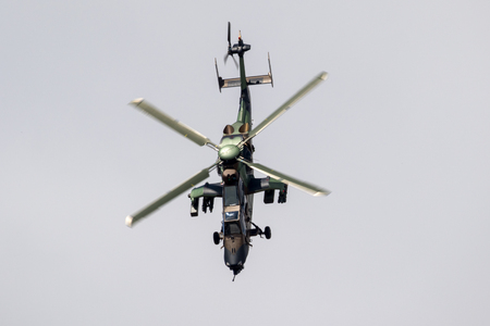 PARIS, FRANCE - JUN 23, 2017: French Army Eurocopter Airbus EC665 Tigre attack helicopter flying at the Paris Air Show 2017