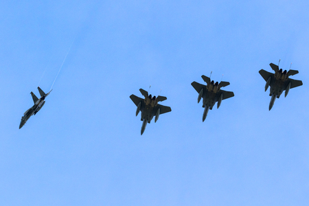 LEEUWARDEN, NETHERLANDS - APR 5, 2017: Formation flight of US Air Force F-15 Eagle fighter jets during exercise Frisian Flag.