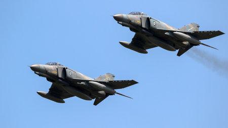 FLORENNES, BELGIUM - JUN 15, 2017: Two Greek Air Force F-4 Phantom fighter jet aircraft in formation flight.