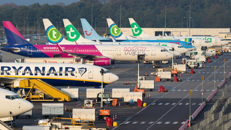 EINDHOVEN, THE NETHERLANDS - OCT 25, 2017: Various low-budget airline aircraft parked at the terminal of Eindhoven-Airport.