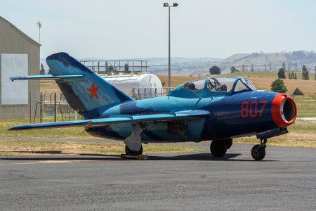 BATHURST, AUSTRALIA - DEC 15, 2012: Vintage Soviet MiG-15 fighter jet on the tarmac of Bathurst airport