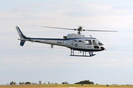 NOWRA, AUSTRALIA - NOV 30, 2005: Royal Australian Navy AS350 helicopter taking off from its homebase HMAS Albatross.