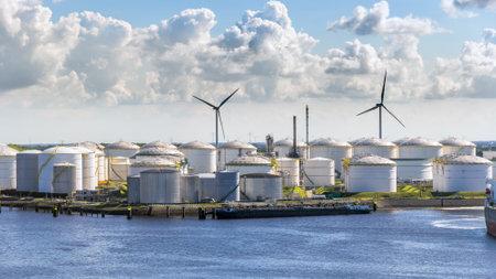 Large port terminal with oil storage silo tanks.