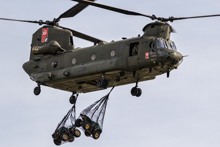 BERLIN - APR 27, 2018: British Royal Air Force Boeing CH-47F Chinook transport helicopter slingload demonstration at the Berlin ILA Air Show.