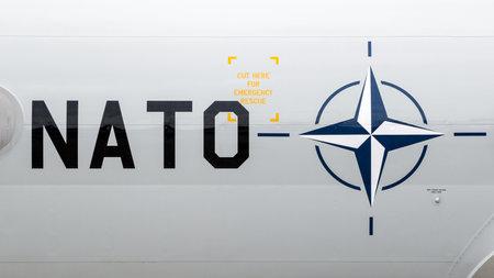 GEILENKIRCHEN, GERMANY - JULY 2, 2017: NATO text and logo on a AWACS E-3 Sentry radar plane at its homebase Geilenkirchen airbase.