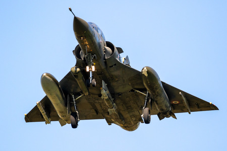 LEEUWARDEN, THE NETHERLANDS - APRIL 19, 2018: French Air Force Dassault Mirage 2000 fighter jet landing on Leeuwarden airbase during exercise Frisian Flag. 에디토리얼