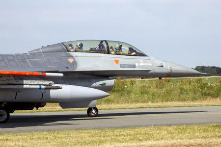 FLORENNES, BELGIUM - JUN 15, 2017: Air Force F16 fighter jet aircraft taxiing towards the runway of Florennes airbase.