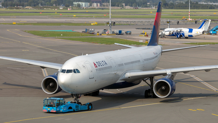 AMSTERDAM - JULY 31, 2014: Delta Air Lines Airbus A330 passenger plane arriving at Schiphol airport