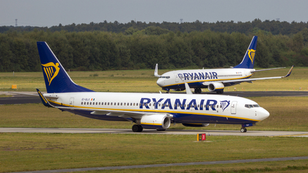 EINDHOVEN, NETHERLANDS - SEP 17, 2016: Boeing 737 passenger planes from Irish low-cost airline Ryanair arriving and departing from Eindhoven Airport.