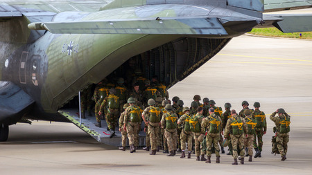 EINDHOVEN, THE NETHERLANDS - SEP 17, 2016: Paratroopers entering a German Air Force C-160 Transall military airplane.