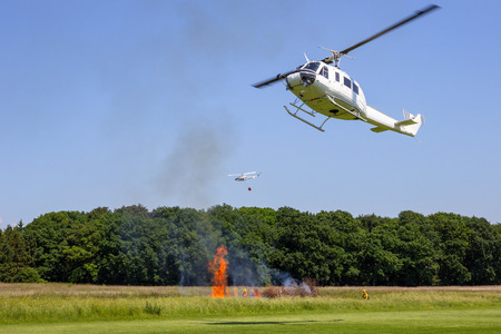 Helicopters in flight during a aerial fire fighting demonstration