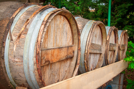 Red wine with barrels stored on vineyard in France Stock Photo