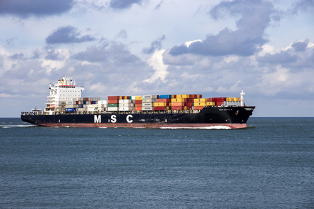 ROTTERDAM, NETHERLANDS - SEP 3, 2016: Container ship from MSC in the North Sea heading to the Port of Rotterdam.