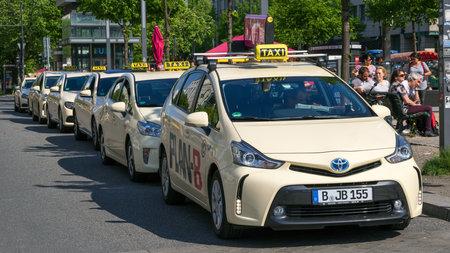BERLIN, GERMANY - APRIL 28, 2018: German taxi cabs waiting near the Brandenburg Gate. Editorial