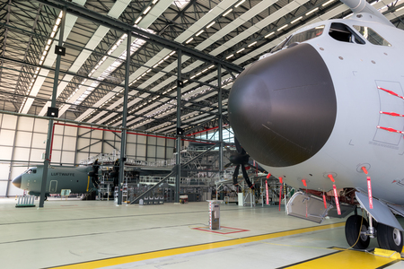 WUNSTORF, GERMANY - JUNE 9, 2018: German Air Force Luftwaffe Airbus A400M military transport planes in a hangar at it`s homebase Wunstorf airbase.