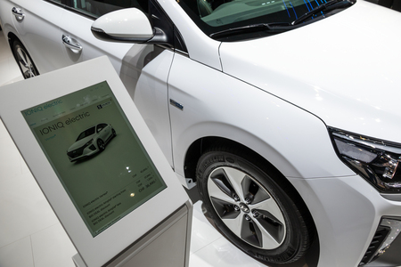 GENEVA, SWITZERLAND - MARCH 6, 2018: Tablet with car information about the Hyundai Ioniq Electric car showcased at the 88th Geneva International Motor Show.