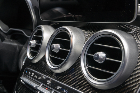 GENEVA, SWITZERLAND - MARCH 6, 2018: Dashboard console view of a Mercedes AMG C43 car showcased at the 88th Geneva International Motor Show.