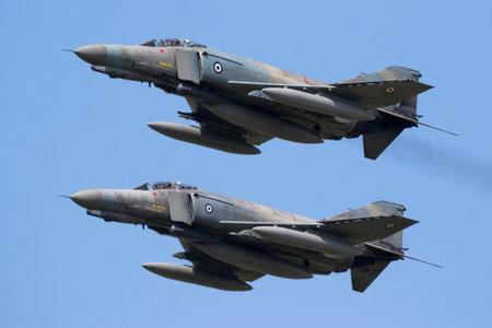 FLORENNES, BELGIUM - JUN 15, 2017: Two Greek Air Force F-4E Phantom fighter jets in formation flight.