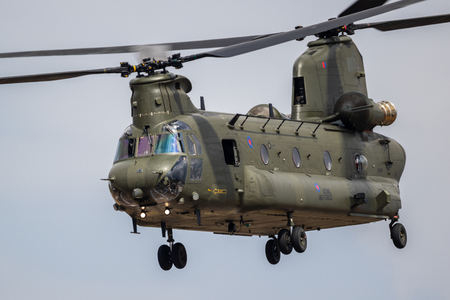 FAIRFORD, UK - JUL 13, 2018: UK Royal Air Force CH-47 Chinook cargo helicopter in flight over RAF Fairford airbase.
