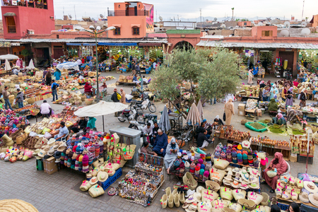 MARRAKESH, MOROCCO - APR 28, 2016: Local people selleing their goods at the berber market in the souks of Marrakech.