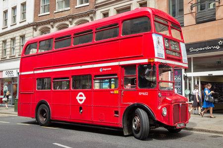 LONDON - JUL 02, 2015: Vintage red double decker bus in a street of London, UK.