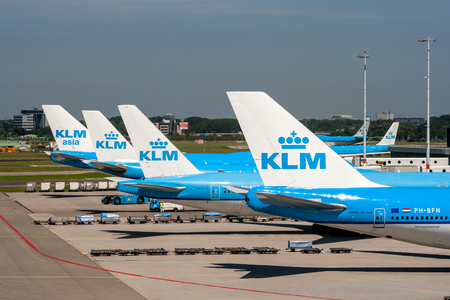 AMSTERDAM, THE NETHERLANDS - JUN 27, 2011: KLM airlines passenger planes at the gates of Amsterdam Schiphol Airport.