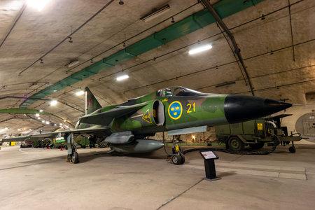 GOTEBORG, SWEDEN - JUL 10, 2011: Saab Viggen fighter jet inside the Aeroseum. The museum is a unique destination inside a declassified Swedish Air Force bunker carved out of solid rock. 報道画像