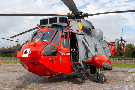 LEEUWARDEN, NETHERLANDS - SEP 17, 2011: British Royal Navy Sea King search and rescue helicopter from 771 Naval Air Squadron idle on Leeuwarden airbase.