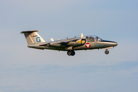 VOLKEL, THE NETHERLANDS - OCT 4, 2010: Austrian Air Force Saab 105 training jet aircraft on final approach. 報道画像