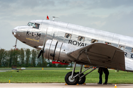 LEEUWARDEN, THE NETHERLANDS - SEP 17, 2011: KLM Royal Dutch Airlines Douglas DC-2 vintage airliner plane on the tarmac of Leeuwarden airbase.