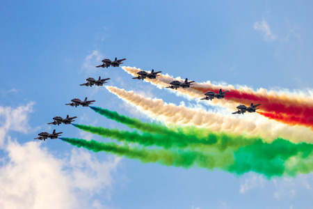 VOLKEL, THE NETHERLANDS - JUN 15, 2013: The Italian aerobatic demonstration team Frecce Tricolori performing with their MB339 jet aircraft at the Dutch Air Force Open Day airshow. Editorial