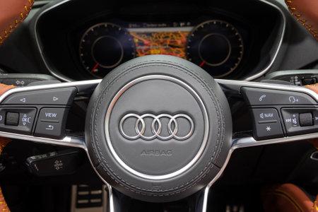 PARIS - OCT 3, 2018: Driver view of the new Audi TT sports car interior at the Paris Motor Show.