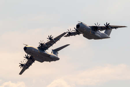 WUNSTORF, GERMANY - JUNE 9, 2018: Formation of two new German Air Force Luftwaffe Airbus A400M military transport planes in flight above their homebase. 報道画像