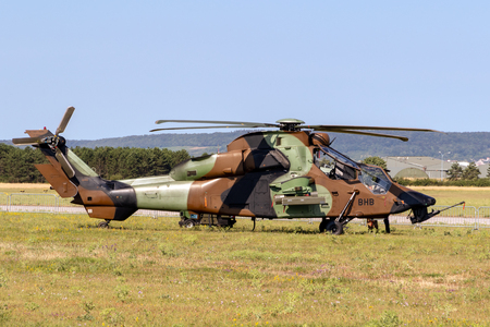 NANCY, FRANCE - JUL 1, 2018: French Army Eurocopter Airbus EC-665 Tiger attack helicopter in the grass of Nancy airbase. Editorial