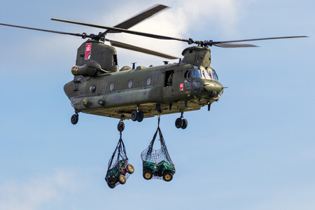 BERLIN - APR 27, 2018: British Royal Air Force Boeing CH-47 Chinook transport helicopter slingload demonstration at the Berlin ILA Air Show.