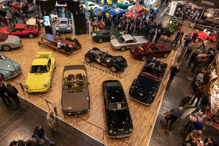ESSEN, GERMANY - MAR 23, 2018: Visitors viewing the classic cars showcased at the Techno Classica Essen vintage car show. Editöryel
