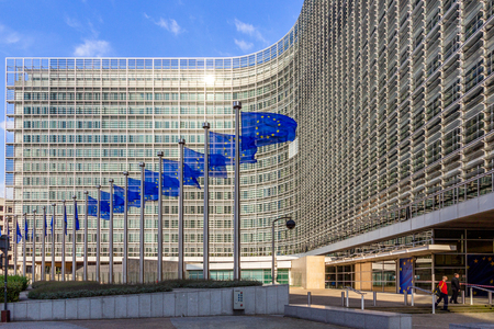 BRUSSELS, BELGIUM - JUL 30, 2014: Row of EU Flags in front of the European Union Commission building in Brussels.
