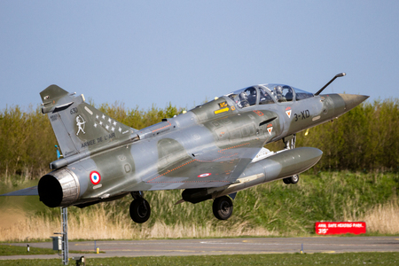LEEUWARDEN, THE NETHERLANDS - APR 21, 2016: French Air Force Dassault Mirage 2000D fighter jet plane from Escadron de Chasse 23 landing on Leeuwarden airbase during military exercise Frisian Flag
