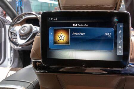 GENEVA, SWITZERLAND - MARCH 7, 2018: Rear seat car entertainment system in a Mercedes Benz lluxury car at the 88th Geneva International Motor Show.
