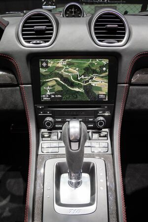 GENEVA, SWITZERLAND - MARCH 6, 2018: Dashboard centre console of the new Porsche 718 Boxster GTS sports carshowcased at the 88th Geneva International Motor Show.