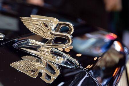 GENEVA, SWITZERLAND - MARCH 6, 2019: Bentley ornament on the hood of a new Bentley car showcased at the 89th Geneva International Motor Show. Editorial