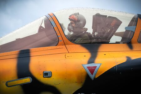 MONT-DE-MARSAN, FRANCE - MAY 17, 2019: Pilot in the cockpit of a special painted Dassault Rafale fighter jet plane taxiing towards the runway at the NATO Tigermeet 2019. Redakční